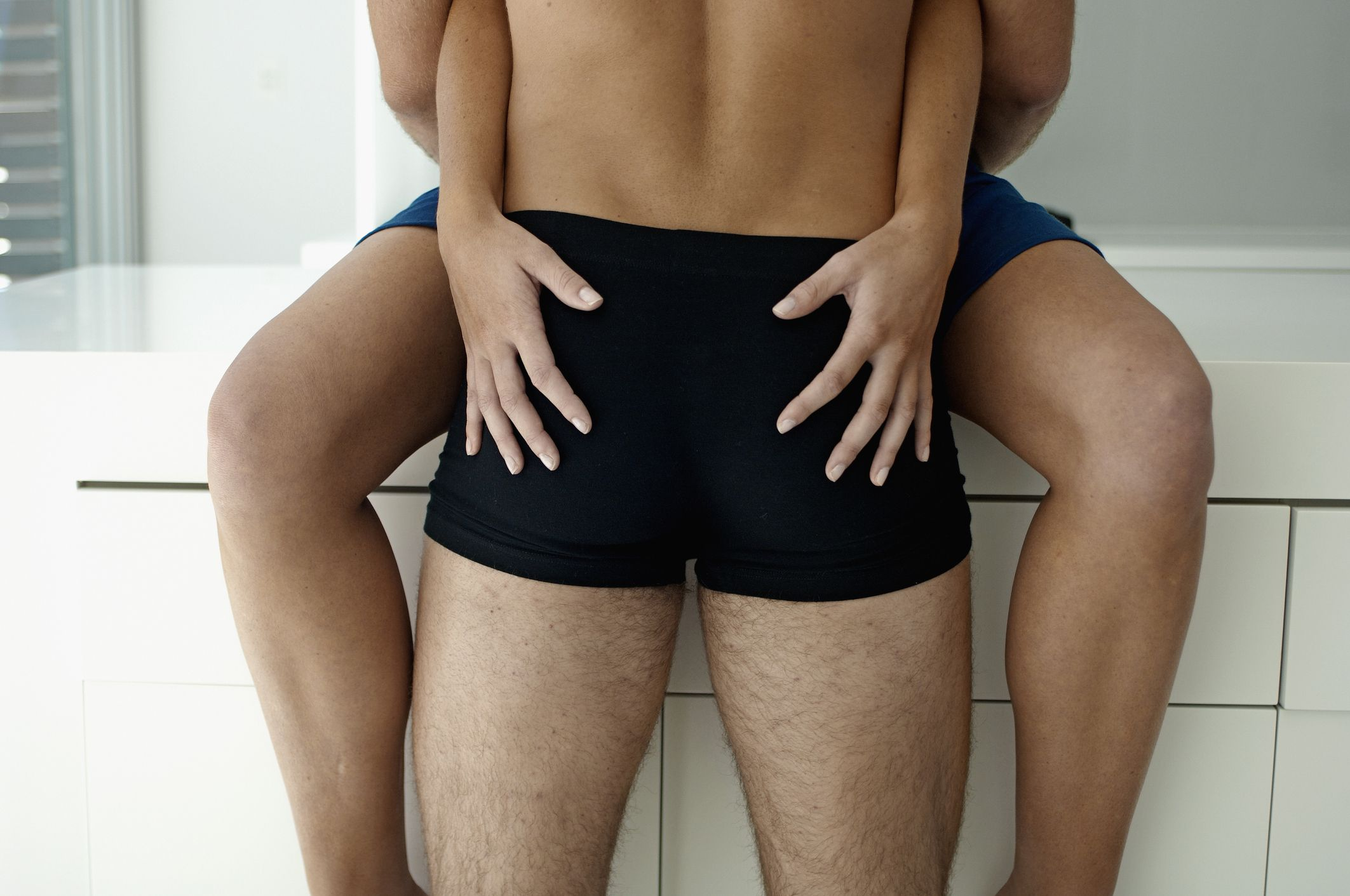 Midsection View of Young Couple Hugging